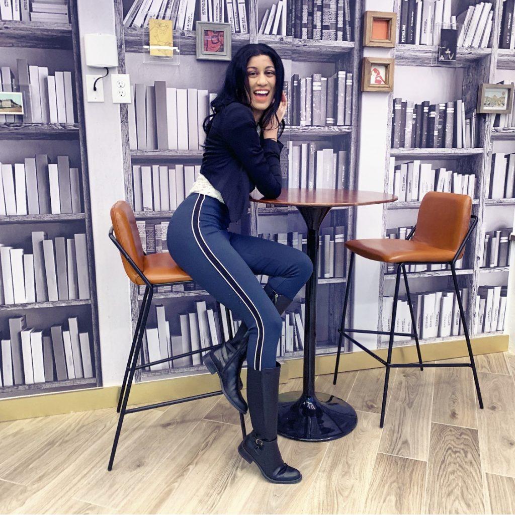 Leslie Quander Wooldridge sitting on a tall chair